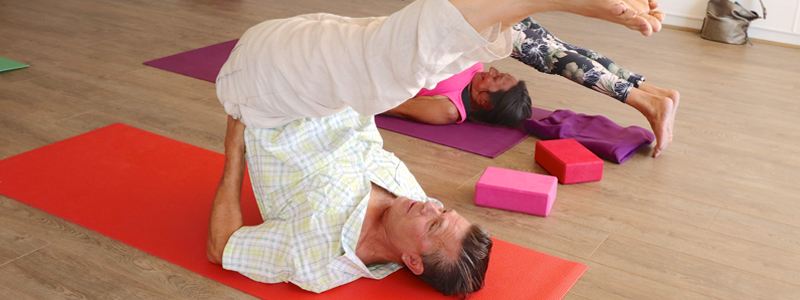 Man-in-yoga-pose-to-help-increase-flexibility-and-posture